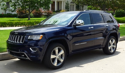 A three-quarter front view of a 2014 Jeep Grand Cherokee Overland 4x4
