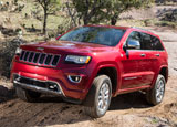A three-quarter front view of a 2013 Jeep Grand Cherokee Overland 4x4