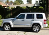 A side view of a silver 2009 Jeep Liberty Limited 4x4