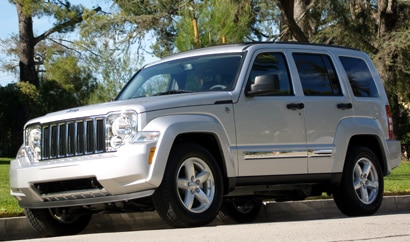 A three-quarter front view of a silver 2009 Jeep Liberty Limited 4x4