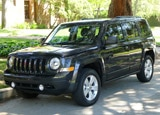 A three-quarter front view of a 2011 Jeep Patriot Latitude 4x4