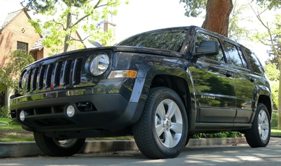 A three-quarter front view of a Jeep Patriot Latitude 4x4
