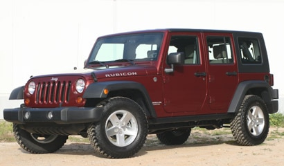 A three-quarter front view of a maroon 2008 Jeep Wrangler Unlimited Rubicon 4x4