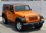 A three-quarter front view of a 2012 Jeep Wrangler Unlimited Sport 4x4
