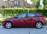 A side view of a red 2011 Kia Forte SX 5-Door