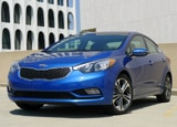 A three-quarter front view of a 2014 Kia Forte EX
