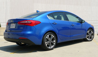 A three-quarter rear view of the Kia Forte EX