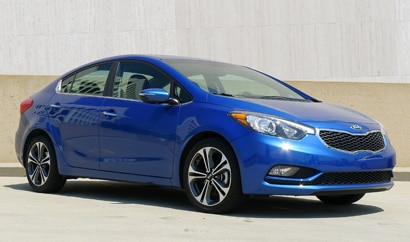 A three-quarter front view of the 2014 Kia Forte EX