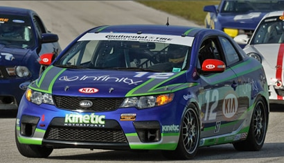 The No. 12 Kia Forte Koup race car on the track at the Homestead Miami Speedway in Miami, Florida