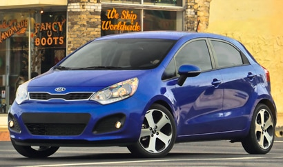 A three-quarter front view of a blue 2012 Kia Rio 5-Door