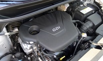 The 1.6-liter direct-injected inline 4-cylinder engine of the 2012 Kia Rio 5-Door SX