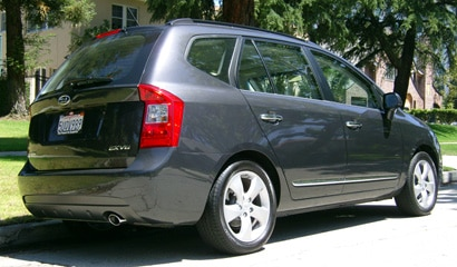 A three-quarter rear view of a 2007 Kia Rondo EX