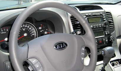 A view of the front interior of a 2008 Kia Sedona EX