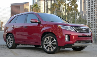 A three-quarter front view of a 2014 Kia Sorento SX FWD