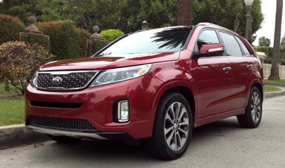 A three-quarter rear view of a 2014 Kia Sorento SX
