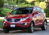 A three-quarter front view of a red 2011 Kia Sportage