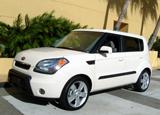 A three-quarter front view of a white 2010 Kia Soul at Miami Beach, Florida