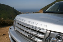 The Range Rover with a Highway 1 bridge in the distance