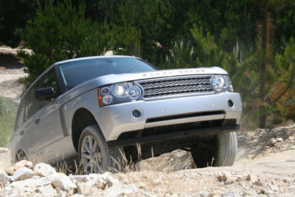 A Range Rover charges up a steep incline