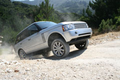 A Range Rover tackles a steep hill