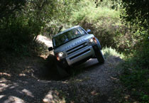 The Land Rover LR3 gets sideways on a steep trail