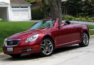 A three-quarter front view of a red 2006 Lexus SC 430