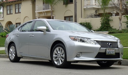A three-quarter front view of a 2013 Lexus ES 300h