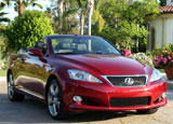 A three-quarter front view of a red 2010 Lexus IS 250C