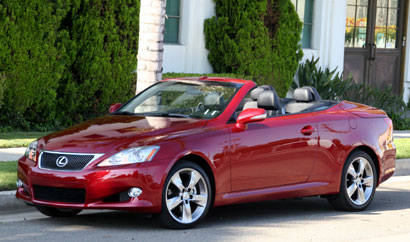 A three-quarter front view of a red 2010 Lexus IS 250C with its hardtop down
