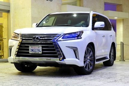 A three-quarter front view of a 2016 Lexus LX570 5-Door SUV shown in Starfire Pearl