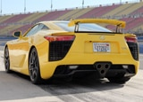 A three-quarter rear view of a yellow 2012 Lexus LFA