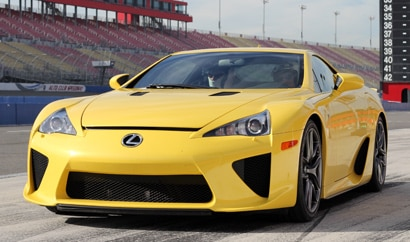 A three-quarter front view of a yellow 2012 Lexus LFA