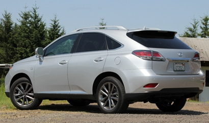 A three-quarter rear view of a silver 2013 Lexus RX 350 F Sport