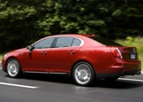 A side view of a red 2009 Lincoln MKS