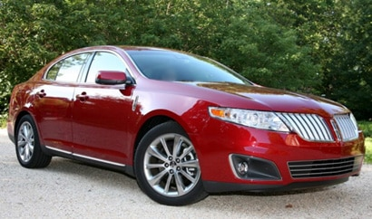 A three-quarter front view of a red 2009 Lincoln MKS