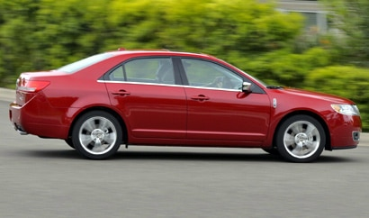 A three-quarter side view of a red 2010 Lincoln MKZ