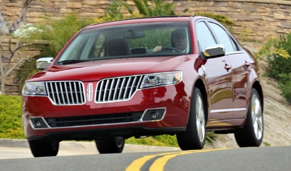 A three-quarter front view of a red 2010 Lincoln MKZ
