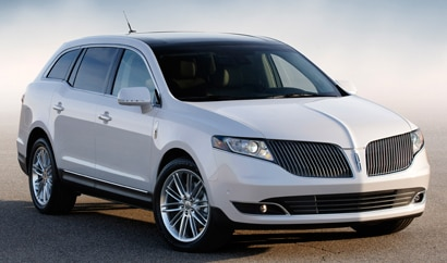 A three-quarter front view of a white 2013 Lincoln MKT