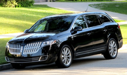 A three-quarter front view of a black 2010 Lincoln MKT EcoBoost