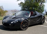 A three-quarter front view of a black Lotus Elise
