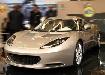 A three-quarter front view of a silver 2010 Lotus Evora on display at the 2008 Los Angeles Auto Show