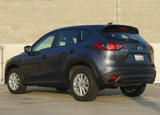 A three-quarter rear view of a 2013 Mazda CX-5 Sport
