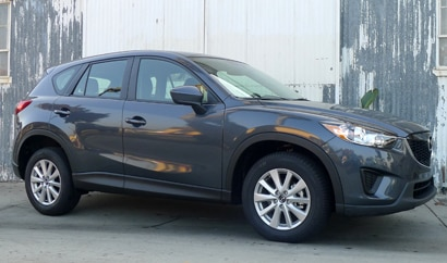A three-quarter front view of a 2013 Mazda CX-5