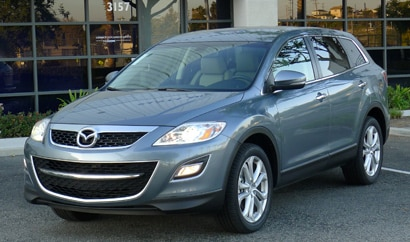 A three-quarter front view of a 2012 Mazda CX-9 Grand Touring AWD