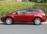 A side view of a red 2010 Mazda CX-7