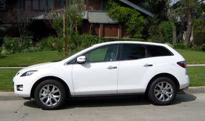 A side view of a white Mazda CX-7