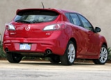 A three-quarter rear view of a 2010 Mazda 3 s Sport