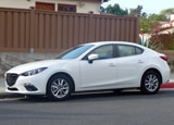 A side view of the 2013 Mazda 3 i 4-Door Touring