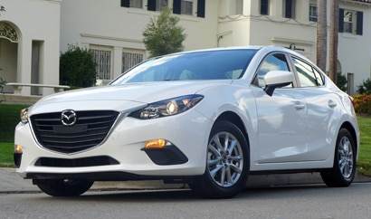 2014 Mazda 3 i 4-Door Touring front three quarter view