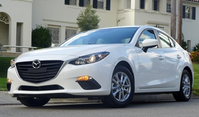 A three-quarter front view of the Mazda 3, one of GAYOT's Top 10 Fuel Efficient Automobiles